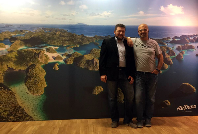 Stas Sedov and Dmitry Moiseenko in front of our panorama of Raja Ampat